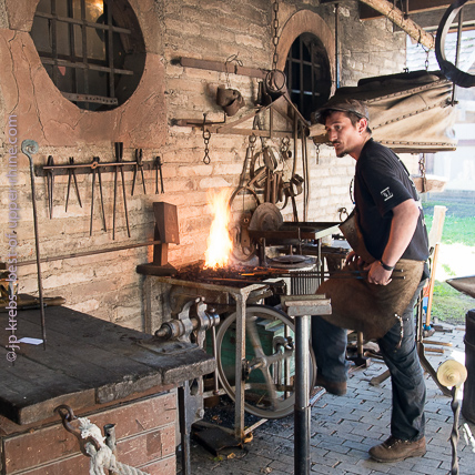 Blacksmith working as in old times.